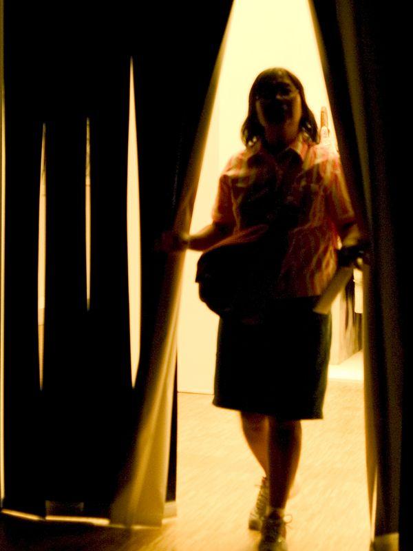 Mercedes entering video art room at the  Musée national d'Art moderne - Centre Georges Pompidou, Paris France, 25 June 05.
