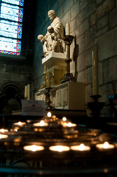 Statue and votive candles in the Cathedral of Norte Dame