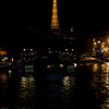 The Eiffle Tower and the Seine River at night