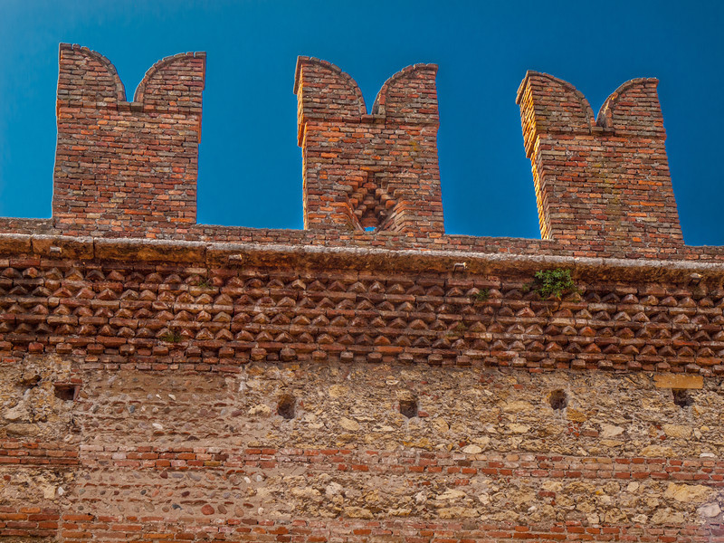 Restored battlements at the Castelvecchio Museum (Italian: Museo Civico di Castelvecchio), a museum in Verona, northern Italy, located in the eponymous medieval castle.  After a long restoration period of restoration, completed in March, 2007, it is now possible to walk through the battlements of the old Scala family's fortress, walking among narrow passages, towers, swallow-tail merlons and a roof garden.