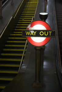 a way out or exit sign in the london underground