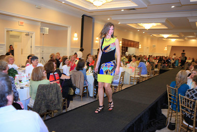 Cathy Lacey models a dress from Collections on Court.