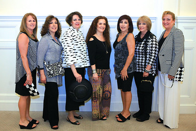 """Ellen Johnson, center, owner of Dixie Riley Clothing and Accessories poses with the volunteers who will be modeling her fashions at the Cranberry Hospice 9th Annual """"Spring into Fashion"""" Show."""