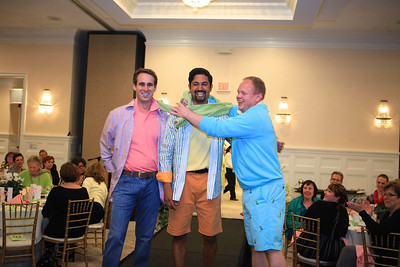 Drs. David Kelly, left, Anit Patel, and Scott James horse around on the runway modeling fashions from Collections on Court at the Cranberry Hospice fashion show to benefit Children Bereavement Programs.