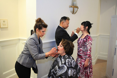 Carlos Febre, owner of FIT Salon, and his assistant Elizabeth Rohde, put the finishing touches on fashion models Phyllis Nelson and Denise Mehegan
