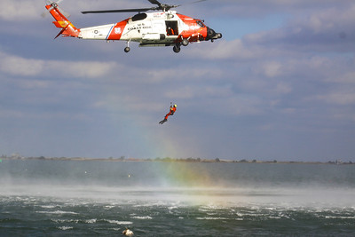 Following the parade, the US Coast Guard demonstrates a sea rescue in Plymouth Harbor.