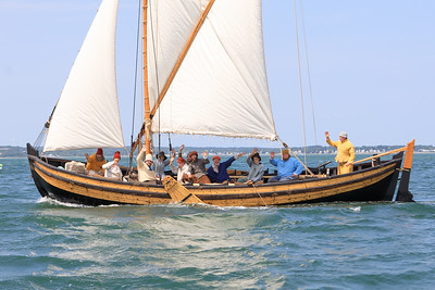 The Shallop crew gives a wave on their way  to Plymouth Harbor and its place next Mayflower Il last Saturday morning.
