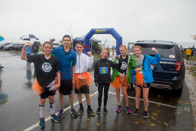 Meet the top 3 male & female Pumpkin Run finishers, all from the Rising Tide Charter School.  From left, 1st Zack Adams, 2nd Ted Zisserson, 3rd Thatcher Kirkpatrick, 1st Olivia Lasnicki, 2nd Claire Zisserson, 3rd, Sam Adams.  Wicked Local Photo/Denise Maccaferri