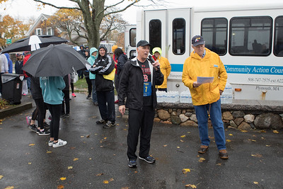 South Shore Community Action Council President & CEO Jack Cocio welcomes over 260 runners to the annual Pumpkin Run 5K fundraiser and promise that the sun will be out before they return. That did not happen!  Wicked Local Photo/Denise Maccaferri