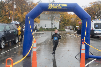 Olivia Lasnicki , 13, is the first female to cross  the Pumpkin run finish line.  Wicked Local Photo/Denise Maccaferri