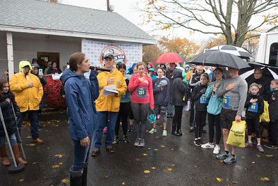 Taylor Johnson, from Plymouth North High School, sings the national Anthem at the South Shore Community Action Council  PumpkingRun.  Wicked Local Photo/Denise Maccaferri