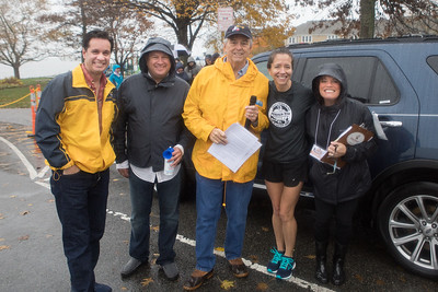 From left, State Senator Vinny deMacedo, State Rep & official race starter Matt Muratore, Emcee and Gatehouse Media /Old Colony Memorial Managing Editor Scott Smith, SSCAC Director of Planning & Development   Nikki Galibois and Community Development Assistant Brenda Green brave the rain at the 4th annual Pumpkin Run 5K held last Saturday at Nelson Park.  Wicked Local Photo/Denise Maccaferri