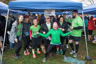 Double lung transplant recipient a year ago,  Patty Furey and the Unleash the Fury team are more than ready to shine in the rain soaked SSCAC Pumpkin Run 5K last Saturday.  Wicked Local Photo/Denise Maccaferri
