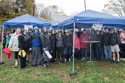 Rain of shine, the Stop & Shop Team  are  perennial participants in the annual South Shore Community Action Council Pumpkin Run fundraiser.  Wicked Local Photo/Denise Maccaferri