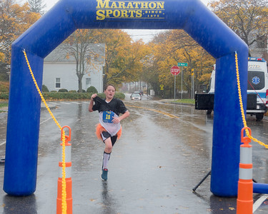 A rain soaked Zack Adams,12, is first to finish the SSCAC Pumpkin Run 5K.  Wicked Local Photo/Denise Maccaferri