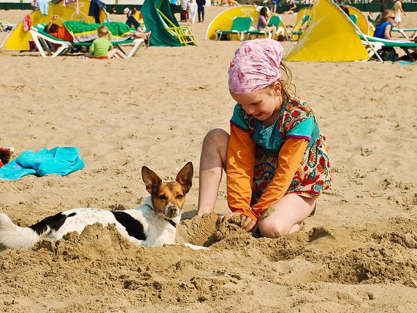 Little Dutch Girl and dog, Thalassa Beach, Holland