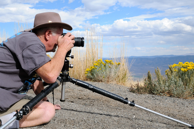 Maybe he needs a smaller tripod?