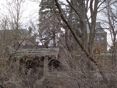An old,  neglected gazebo and its mansion at Milwaukee's Lakefront. The staircase below it once lead to the shoreline of Lake Michigan.
