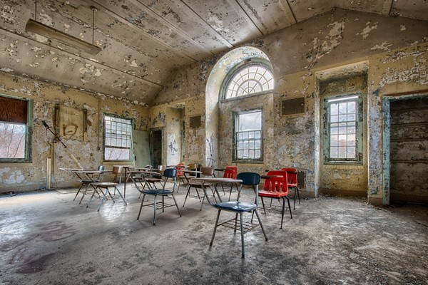 A classroom setup inside one of the original wards (also known as cottages).