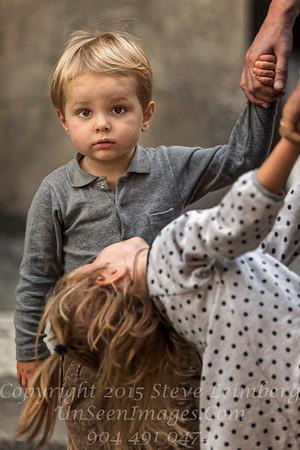 Little Boy and Admiring Sister - Copyright 2016 Steve Leimberg - UnSeenImages Com_H1R9427