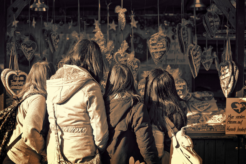 Girls picking christmas cookies at the Christmas Market in Frankfurt<br /> <br /> Processed with CS4 & Topaz BW