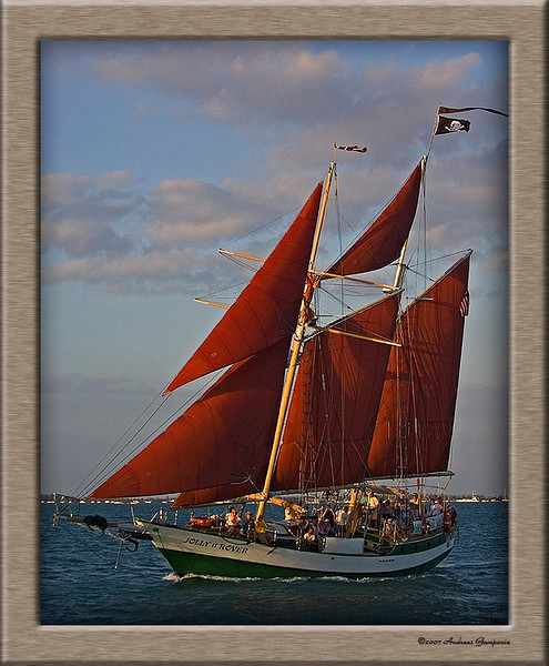 "While under way on our sunset champagne excursion, we were accosted on the high seas by the pirate vessel ""Jolly Rover"" who made a broadside pass alongside and fired her below deck guns.  She undoubtedly had observed we had limitless champagne, ale and beautiful women on board!"