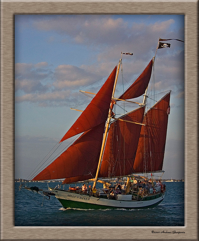 """While under way on our sunset champagne excursion, we were accosted on the high seas by the pirate vessel """"Jolly Rover"""" who made a broadside pass alongside and fired her below deck guns.  She undoubtedly had observed we had limitless champagne, ale and beautiful women on board!"""