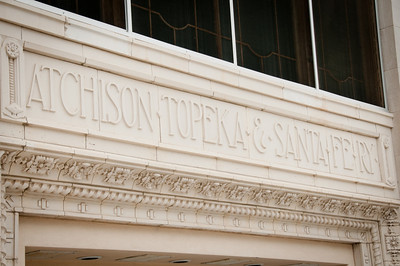 Front of state building bearing the words Atchison, Topeka and Santa Fe Railway:  one of the larger railroads in the United States.