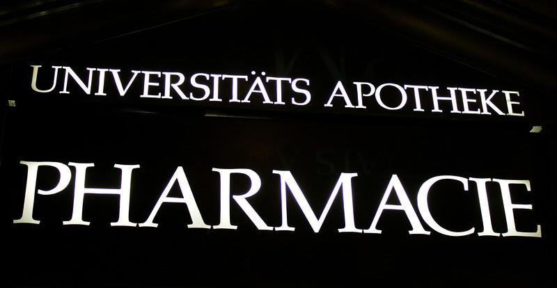 Germany, Heidelburg, Pharmacy Sign at Night