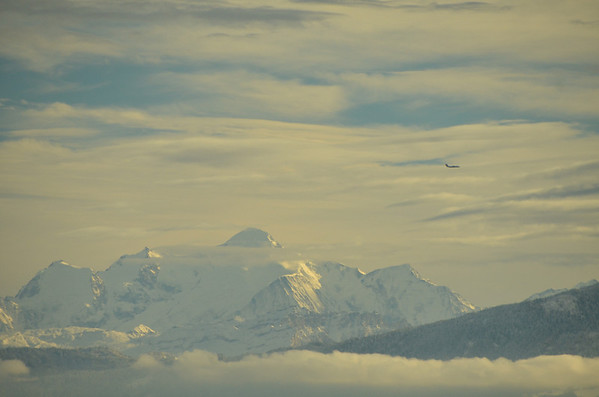 View from the Vy de l'Etraz, west of Gingins, on a rare sunny day, 27 December, 2013.<br /><br />Mt. Blanc, with a plane on approach to Geneva View SSE  over Gingins towards the Alps
