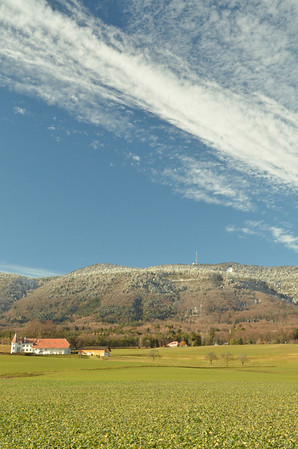 View from the Vy de l'Etraz, west of Gingins, on a rare sunny day, 27 December, 2013.<br /><br />Farm at the foot of the Jura, with La Dôle and la Barillette on the skyline. View SSE  over Gingins towards the Alps