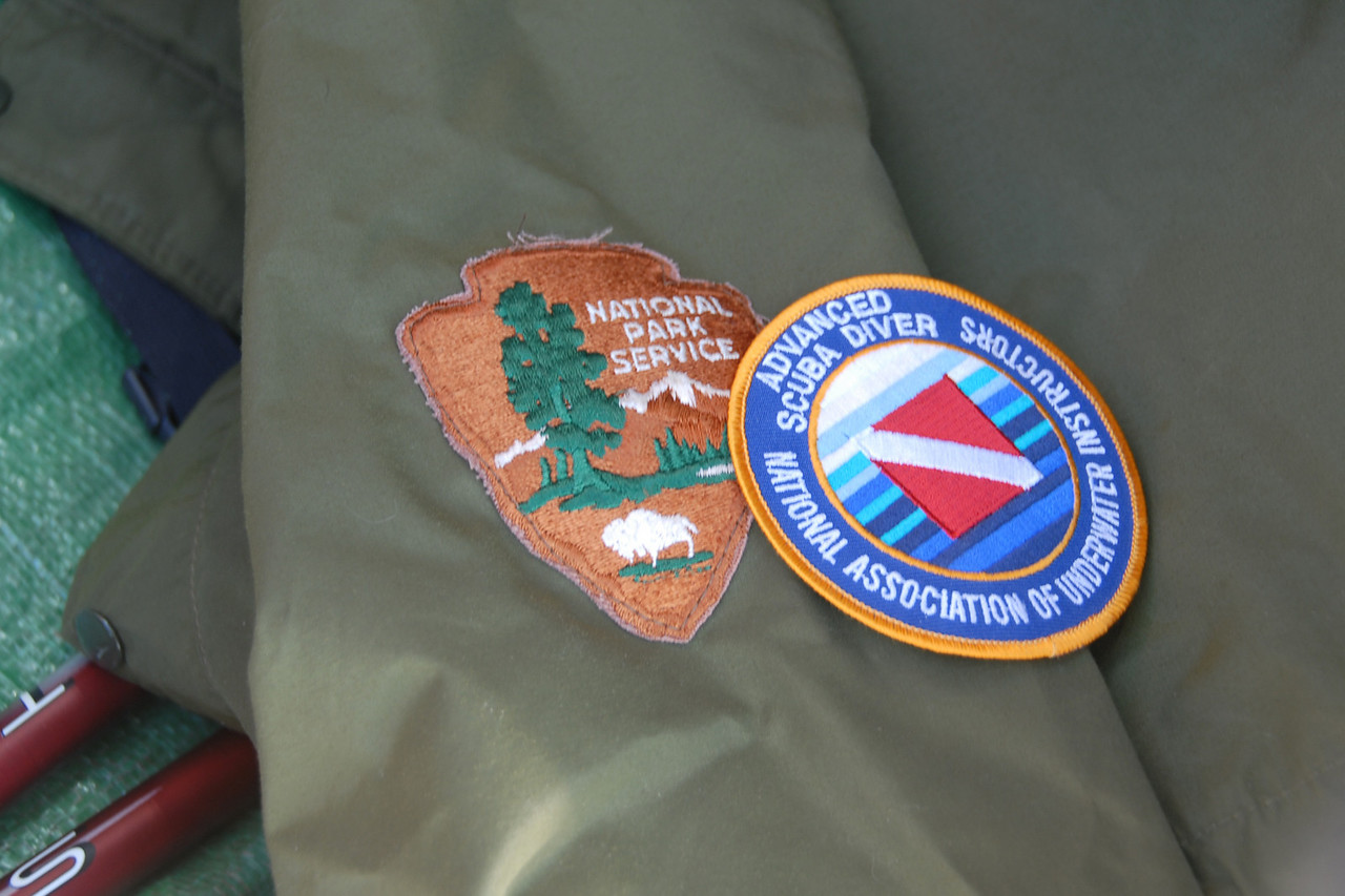 Mark had to cover the patch on his park ranger jacket.