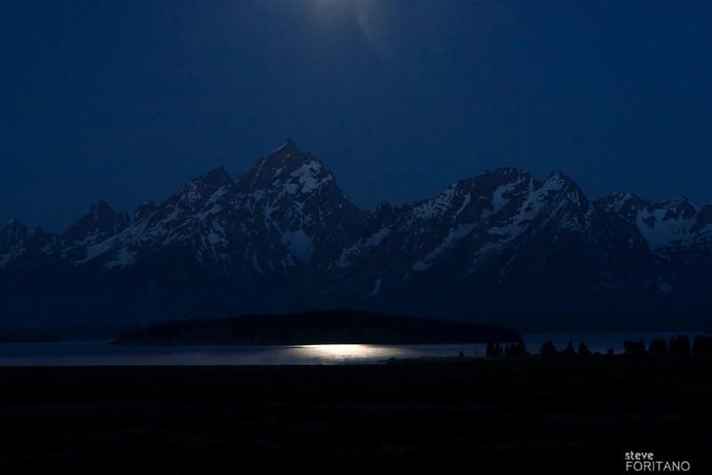 Moon rays reflecting off Jackson Lake, Grand Teton National Park