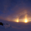 "Sundog <br /> <br /> One night Lisa left the tent and yelled to me ""there's three suns""! I responded in my sleep <br /> that I didn't understand what she was talking about and please let me rest. When she finally <br /> coaxed me out of the tent I was presented a perfect Sundog. This phenomenon is caused by <br /> light refraction and is particularly spectacular in the Polar Regions."