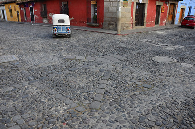 Tuk-tuk taxi and Antigua's infamous, old cobble stone streets.