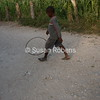 Haitian Boy and Toy