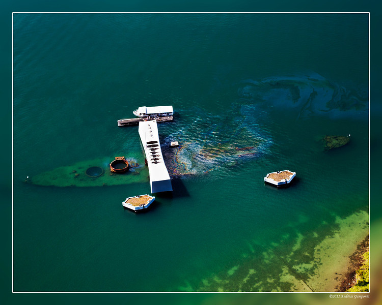 The USS Arizona Memorial.  It still leaks a little oil from all those years ago...