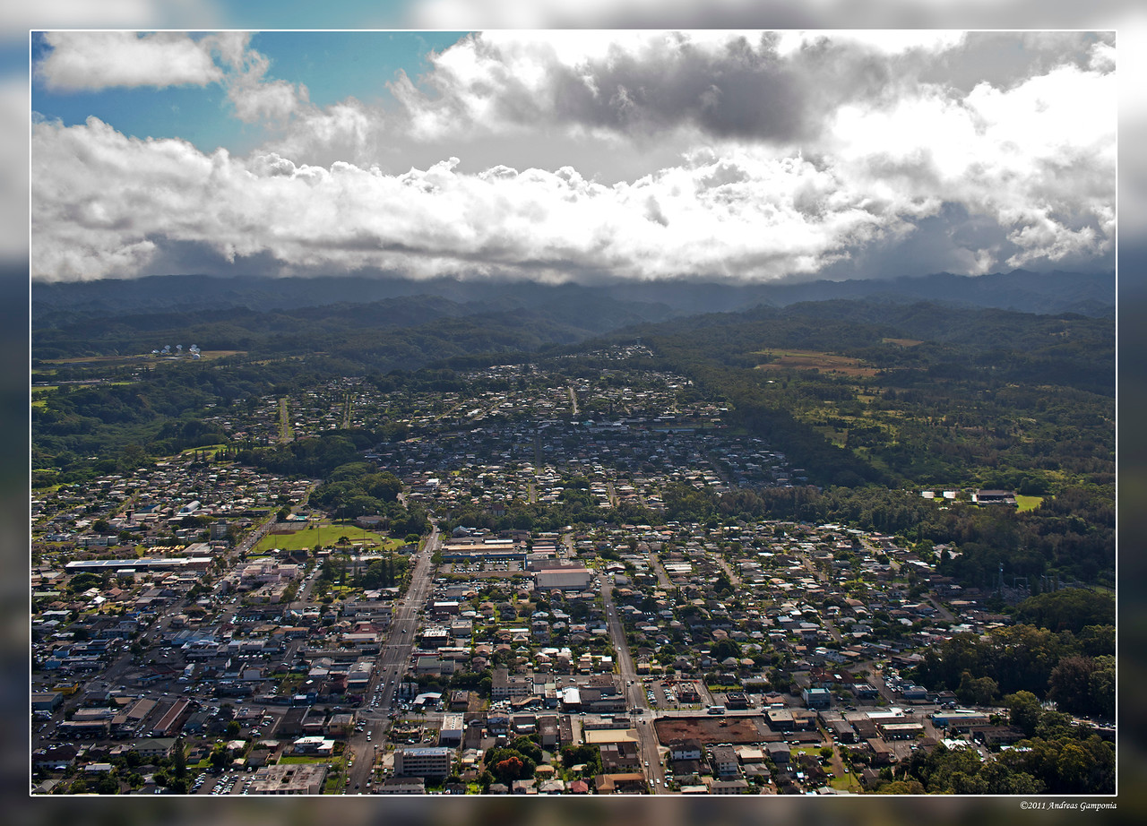 This is Wahiawa town in the middle of the island in Oahu.  I lived in Wahiawa Heights straight up in the center back of the town in the photo.
