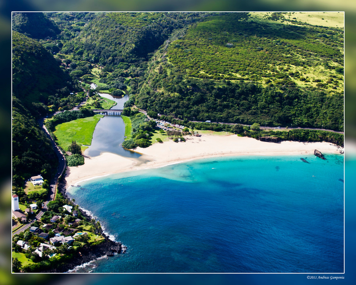 This is Waimea Bay and the entrance to Waimea canyon that leads to Waimea falls.  This is on the famous North Shore of Oahu where in the winter time, the surf is world class.