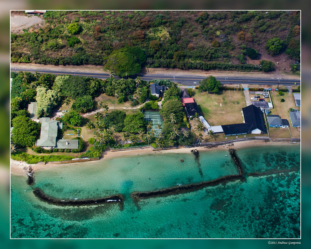A famous property on the eastern side of Oahu.  If you watched enough TV, you should recognize the main house and tennis courts.  The red ferrari is not seen anywhere in this photo.
