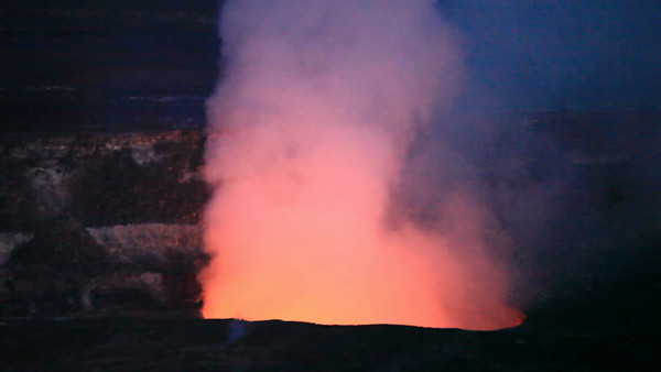Video of smoke rising from Kilauea Volcano, Hawaii, lit by the lava below.