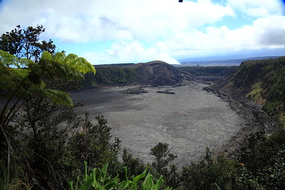 An older volcanic crater. The scale is deceptive - the crater walls are about 40 stories tall.  At the full resolution of this photo you would not be able to distinguish people walking on the floor.