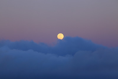 Moonrise over fast-moving clouds.
