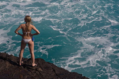 Girl on rocks, south shore of Oahu