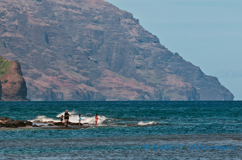 Morning fishing at Ke'e beach, with Na Pali coast as backdrop