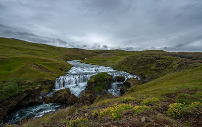 Hiking a bit uphill leads you to beautiful broad view at upper stream of Skogafoss.