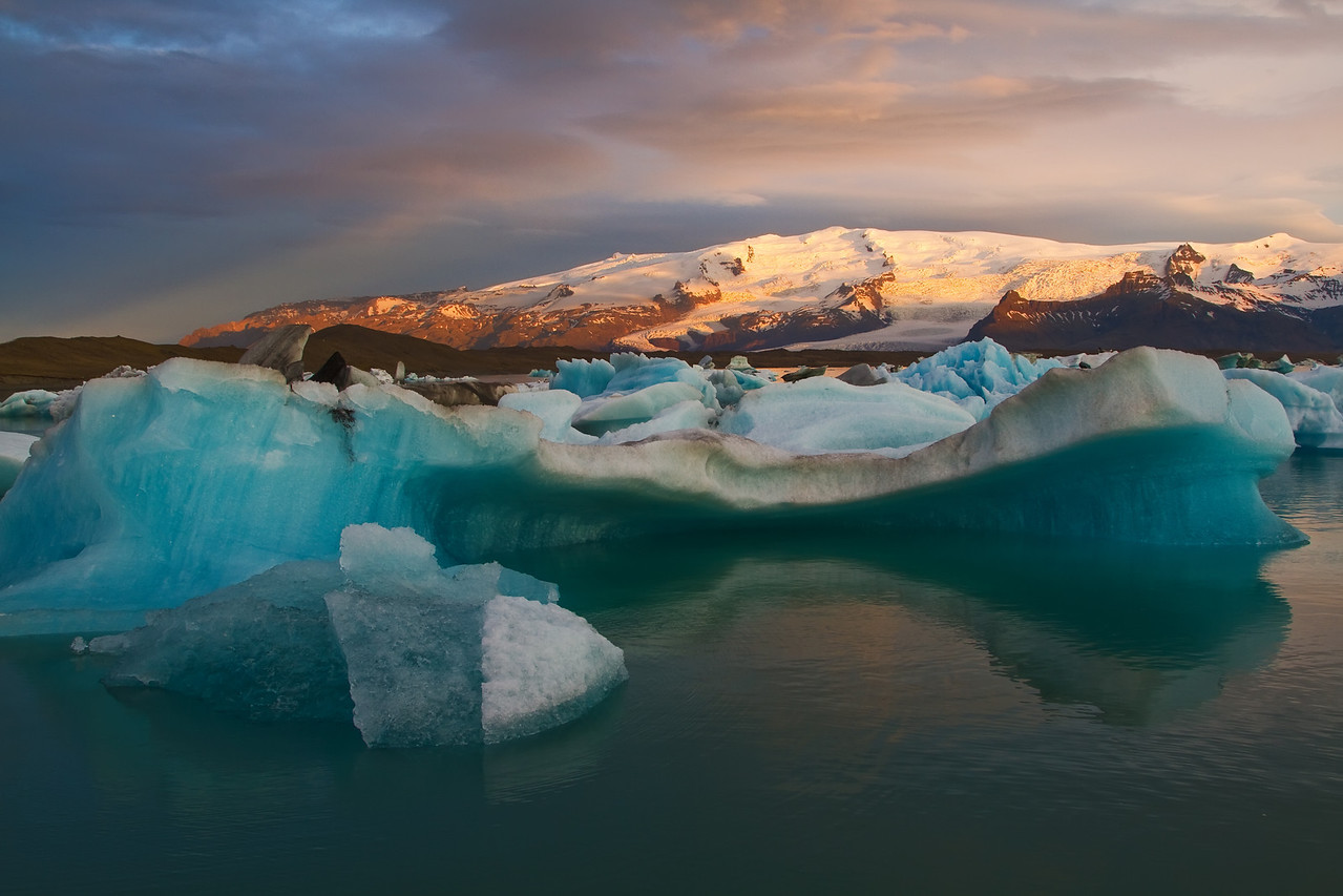 <H3>Icy Alpenglow </H3> Dawn at Jokulsarlon, South Iceland