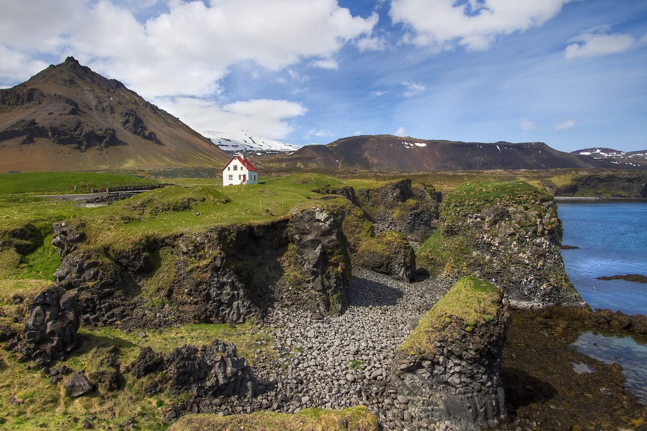 <H3> Arnarstapi </H3> Its hard to beat this beautiful setting to build a house....Arnarstapi is a small town in the Snaefellsnes Peninsula and its easy to see why its a popular spot for summer houses