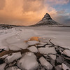 "<span class=""AaronsSubTitle"">Sunrise over a frozen Kirkjufell Mountain Grundarfjörður, Iceland</span>  The frozen lagoon at Kirkjufell Mountain. I loved the way the ice formed here."
