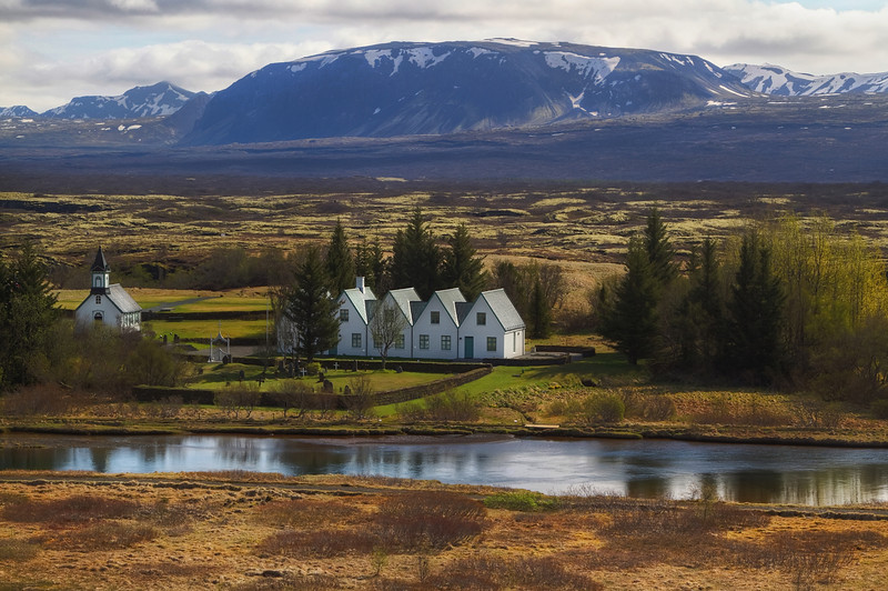 <H3>Þingvellir National Park </H3> Set on the picturesque valley right where the North American tectonic plate tears away from the Eurasian plate, Þingvellir National Park is the most historically significant site in Iceland.This is where the Vikings established the first parliament (Alþingi) in 930 AD and is where all important decisions affecting the country were made.   The Church to the left, Þingvallakirkja is one of the first in Iceland consecrated in the 11th century but the current structure dates back to the mid 19th century. The house to the right (Þingvallabaer built on the 1000th anniversary of the Alþingi in 1930) serves as the Prime Minister's summer home.
